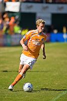Houston Dynamo midfielder Stuart Holden (22) dribbles the ball. Houston Dynamo tied Los Angeles Galaxy 0-0 at Robertson Stadium in Houston, TX on October 18, 2009.