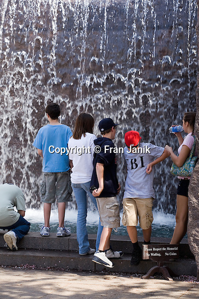 Several boys and girls enjoy the waterfall during their visit the FDR Memorial in Washington DC