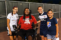 Eric LeGrand poses for a photo with Portland Thorns forward Alex Morgan (13) and Sky Blue FC defender Christie Rampone (3) after the match. Sky Blue FC and the Portland Thorns played to a 0-0 tie during a National Women's Soccer League (NWSL) match at Yurcak Field in Piscataway, NJ, on June 22, 2013.