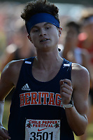 NWA Democrat-Gazette/ANDY SHUPE<br /> Heritage's Lawson Douglas nears the finish line Saturday, Oct. 5, 2019, during the Chile Pepper Cross Country Festival at Agri Park in Fayetteville. Visit nwadg.com/photos to see more photographs from the races.