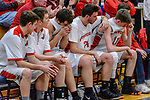 WATERBURY, CT. 14 March 2018-031418BS686 - From right, Northwestern players Benjamin North (11), Michael Neumann (24), Jayson Reola (10), and other teammates along the bench show their dejection after coming up short against Kolbe Cathedral in the Div IV semi-finals at Kennedy High School on Wednesday evening. Bill Shettle Republican-American