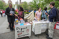 New York, NY USA - 1 May 2017 - Members of the Socialist Alternative tabeling at a May Day rally, speak with the media.