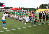 Michelle Akers kicks out first ball to Marta #10 of Marta's XI during the WPS All-Star game at KSU Stadium in Kennesaw, Georgia on June 30 2010. Marta XI won 5-2.