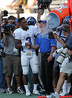 Armwood Hawks wide receiver Alvin Bailey distracts head coach Sean Callahan as teammates dump the water over his head during the fourth quarter of the Florida High School Athletic Association 6A Championship Game at Florida's Citrus Bowl on December 17, 2011 in Orlando, Florida.  Armwood defeated Miami Central 40-31.  (Mike Janes/Four Seam Images)