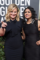 Actor Amy Poehler and Saru Jayaraman attend the 75th Annual Golden Globes Awards at the Beverly Hilton in Beverly Hills, CA on Sunday, January 7, 2018.<br /> *Editorial Use Only*<br /> CAP/PLF/HFPA<br /> &copy;HFPA/PLF/Capital Pictures