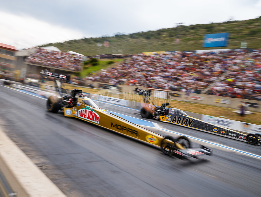 Jul 23, 2017; Morrison, CO, USA; NHRA top fuel driver Leah Pritchett (near) races alongside Tony Schumacher during the Mile High Nationals at Bandimere Speedway. Mandatory Credit: Mark J. Rebilas-USA TODAY Sports