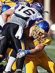 BROOKINGS, SD - OCTOBER 26:  Dallas Brown #1 from South Dakota State University brings down Logan Cunningham #16 from Northern Iowa in the first quarter of their game Saturday afternoon at Coughlin Alumni Stadium in Brookings. (Photo by Dave Eggen/Inertia)