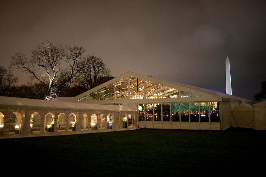 A tent on the South Lawn of the White House seated over 400 people attending the first official State Dinner of President Obama's administration for Indian Prime Minister Manmohan Singh...............
