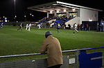 Bishop Auckland 3 West Auckland Town 1, 22/01/2016. Heritage Park, Northern League Division One. A man standing behind the goal in the first half watching the action as Bishop Auckland take on West Auckland Town in a Northern League division one match at Heritage Park. Bishop Auckland were winners of the Amateur Cup 10 times between 1895 and 1957 whilst their opponents won the Sir Thomas Lipton Trophy, regarded as the first world club tournament, in 1909 and 1911.  Bishop Auckland won this fixture 3-1, watched by a crowd of 422 at the ground they moved into in 2010. Photo by Colin McPherson.