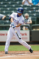 Round Rock Express designated hitter Kensuke Tanaka #8 swings the bat during the Pacific Coast League baseball game against the Memphis Redbirds on April 27, 2014 at the Dell Diamond in Round Rock, Texas. The Express defeated the Redbirds 6-2. (Andrew Woolley/Four Seam Images)