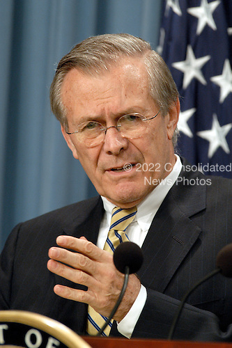 United States Secretary of Defense Donald H. Rumsfeld tells reporters how the Iraqi regime is using hospitals as military headquarters, schools as armories and moving artillery pieces into Baghdad residential neighborhoods.  Rumsfeld and Chairman of the Joint Chiefs of Staff Gen. Richard B. Myers, U.S. Air Force, gave reporters an update on the progress of Operation Iraqi Freedom during an April 7, 2003, Pentagon press briefing.  <br /> Mandatory Credit: Helene Stikkel / DoD via CNP