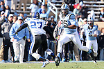 30 November 2013: UNC's Eric Ebron (85) and Duke's DeVon Edwards (27). The University of North Carolina Tar Heels played the Duke University Blue Devils at Keenan Memorial Stadium in Chapel Hill, NC in a 2013 NCAA Division I Football game. Duke won the game 27-25.