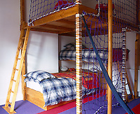 Part-playframe, part pirate's lair the bed is arranged in a series of platforms with access via ladders and fisherman's netting