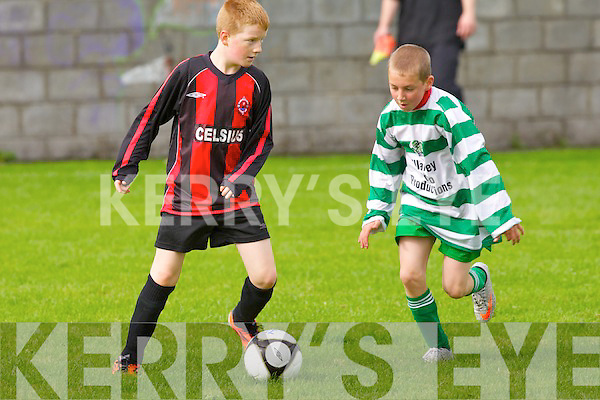 St Brendan's Park B's Evan Maher and Killarney Celtic B's Grigoriy Geniyevskiy.