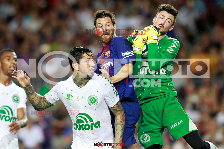 FC Barcelona's Leo Messi (c) and Chapecoense's Victor Ramos (l) and Elias Curzel during Joan Gamper Trophy. August 7,2017. (ALTERPHOTOS/Acero) /NortePhoto.com