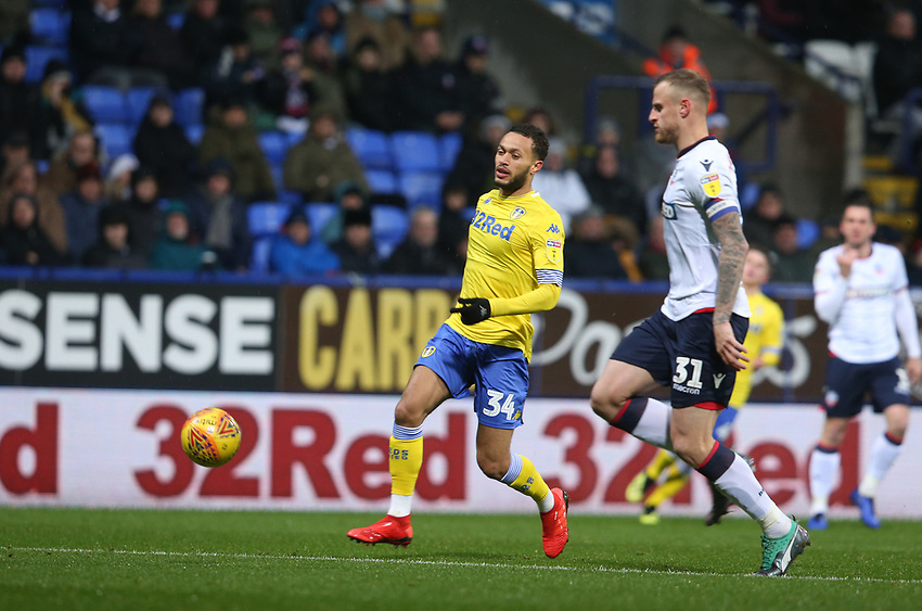 Leeds United's Lewis Baker and Bolton Wanderers' David Wheater<br /> <br /> Photographer Stephen White/CameraSport<br /> <br /> The EFL Sky Bet Championship - Bolton Wanderers v Leeds United - Saturday 15th December 2018 - University of Bolton Stadium - Bolton<br /> <br /> World Copyright © 2018 CameraSport. All rights reserved. 43 Linden Ave. Countesthorpe. Leicester. England. LE8 5PG - Tel: +44 (0) 116 277 4147 - admin@camerasport.com - www.camerasport.com