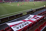 A visiting fan's flag adorns the seats during the second half of Crewe Alexandra's home game against Leyton Orient (in yellow) in the SkyBet League One at the Alexandra Stadium, Gresty Road, Crewe. The match was won by the visitors from London by 2-1 with two goals on debut by Chris Dagnall, sending Orient to the top of the league. The match was watched by 4830 spectators.