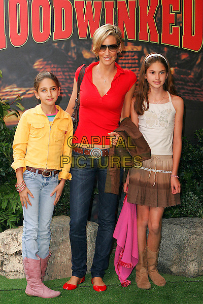 "LISA BUTCHER & DAUGHTERS.At the UK Film Premiere of ""Hoodwinked"",.Vue West End Cinema, London,.England, September 24th 2006..full length kids children mum mother family red top silver cross necklace sunglasses belt shoes jeans.Ref: DAR.www.capitalpictures.com.sales@capitalpictures.com.©Darwin/Capital Pictures"