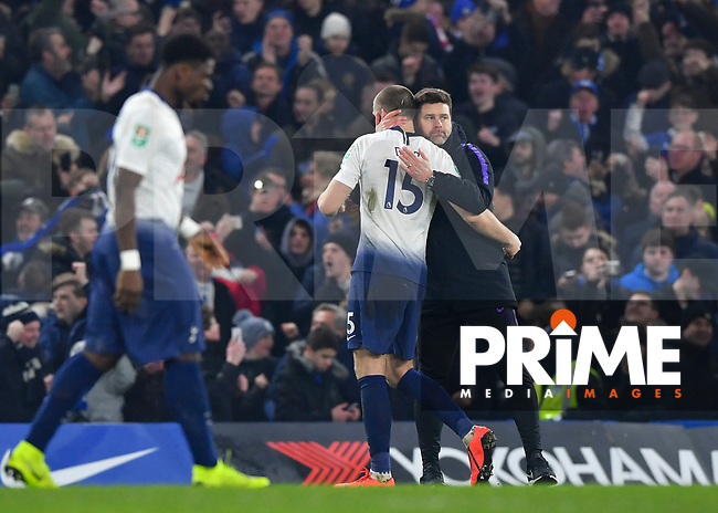 Eric Dier of Tottenham Hotspur is consoled by Mauricio Pochettino manager of Tottenham Hotspur during the Carabao Cup Semi-Final 2nd leg match between Chelsea and Tottenham Hotspur at Stamford Bridge, London, England on 24 January 2019. Photo by Vince  Mignott / PRiME Media Images.