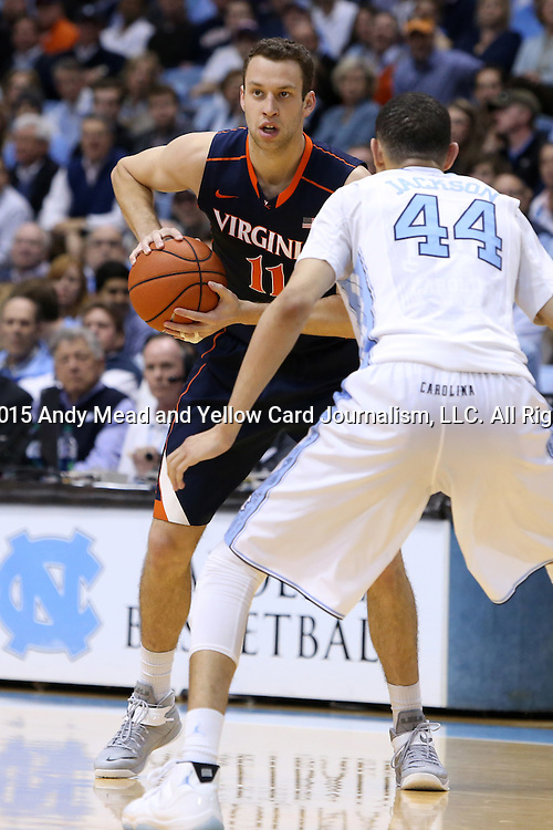 02 February 2015: Virginia's Evan Nolte (11) and North Carolina's Justin Jackson (44). The University of North Carolina Tar Heels played the University of Virginia Cavaliers in an NCAA Division I Men's basketball game at the Dean E. Smith Center in Chapel Hill, North Carolina. Virginia won the game 75-64.