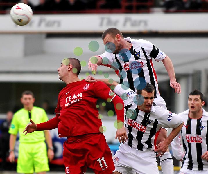 Scott Wilson wins a high ball during the Dunfermline v Aberdeen Homecoming Scottish Cup quarter final tie at East End Park