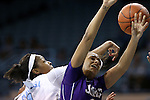 02 January 2014: North Carolina's Stephanie Mavunga (1) fouls JMU's Precious Hall (right). The University of North Carolina Tar Heels played the James Madison University Dukes in an NCAA Division I women's basketball game at Carmichael Arena in Chapel Hill, North Carolina.