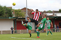 Leon Mckenzie of Hornchurch ahead of Lewis Endicott and Harry Norman of Soham during AFC Hornchurch vs Soham Town Rangers, Bostik League Division 1 North Football at Hornchurch Stadium on 12th August 2017