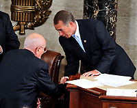 United States House Speaker John Boehner (Republican of Ohio), right, shakes hands with U.S. Representative John Dingell (Democrat of Michigan), left, after Dingell swore-in Boehner at the opening of the 112th Congress in the U.S. Capitol in Washington, D.C. on Wednesday, January 5, 2011.Photo Credit: Ron Sachs/CNP/AdMedia