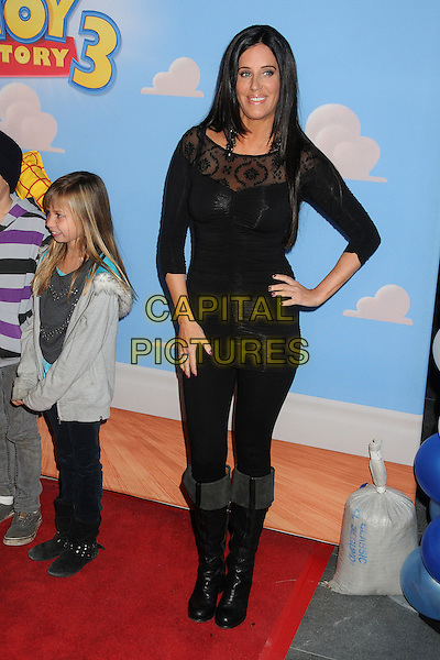 Patti Stanger.Disney•Pixar's Toy Story 3 Disney On Ice held at Nokia Plaza L.A. Live, Los Angeles, California, USA..December 14th, 2011.full length top jeans denim boots hand on hip black lace .CAP/ADM/BP.©Byron Purvis/AdMedia/Capital Pictures.