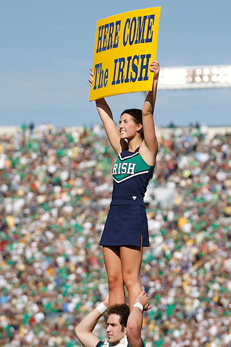 Notre Dame cheerleader performs during NCAA football game between Pittsburgh and Notre Dame.  The Notre Dame Fighting Irish defeated the Pittsburgh Panthers 23-17 in game at Notre Dame Stadium in South Bend, Indiana.