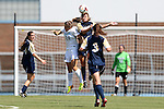 15 September 2013: Notre Dame's Sammy Scofield (center) heads the ball over North Carolina's Paige Nelsen (24). The University of North Carolina Tar Heels hosted the University of Notre Dame Fighting Irish at Fetzer Field in Chapel Hill, NC in a 2013 NCAA Division I Women's Soccer match. Notre Dame won the game 1-0.
