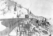 D&amp;RG C-16 or C-19 with large wedge plow eastbound on Cascade Creek Trestle about 1920.  Trestle painted black.<br /> D&amp;RG  Osier, CO  ca. 1920