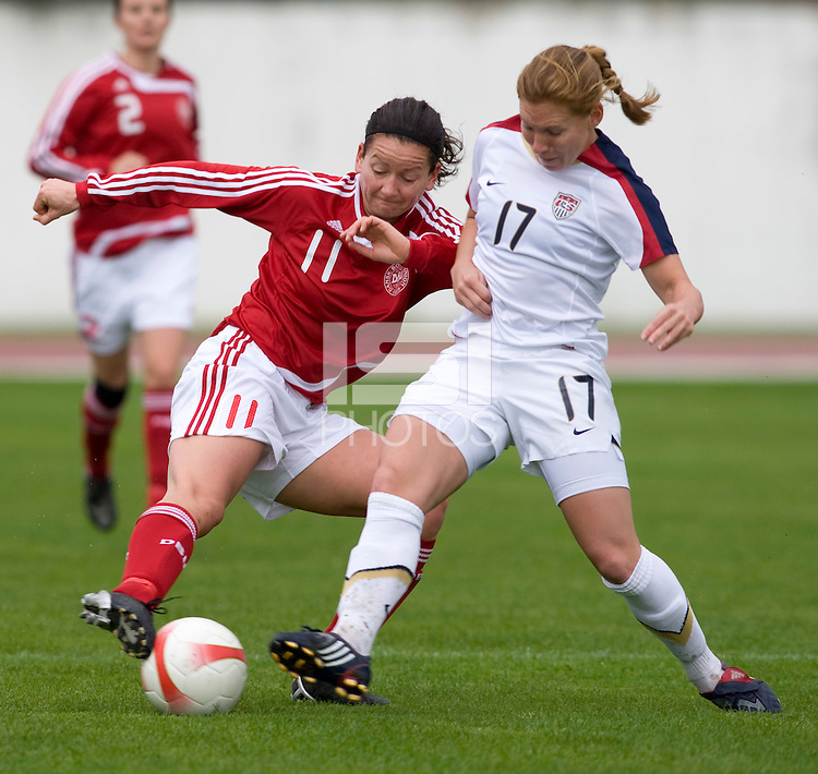 USWNT defender (17) Lori Chalupny fights for the ball with Denmark's (11) Merete Pedersen during the opening match of the Algarve Cup.  The USWNT defeated Denmark, 2-0, in Lagos, Portugal.