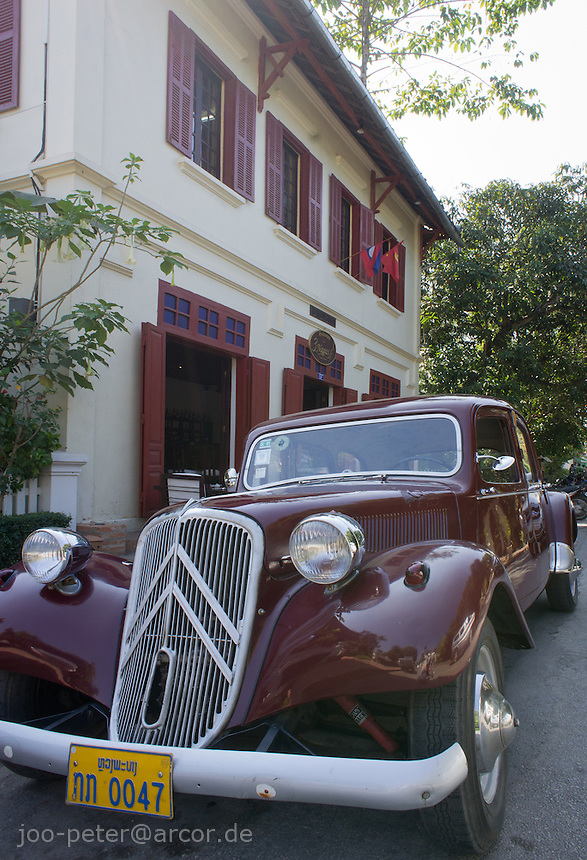 french oldtimer (Citroen) in front of a building of colonial times in Luang Prabang, Laos, 2012