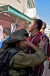 An Israeli soldier prevents the passage of Palestinians during a demonstration against the closure of Shuhada Street to Palestinians in the city of Hebron on 05.06.2010
