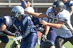 Torrance, CA 09/05/13 - Corey Cox  (North #1) and Luke Megginson (Peninsula #78) in action during the Peninsula vs North Junior Varsity football game played at North High School in Torrance, California.