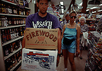 Campers purchase firewood in boxes at the store in Yosemite Valley.  Tourists can buy food, alcohol and any amenities or supplies they forgot on their wilderness experience.