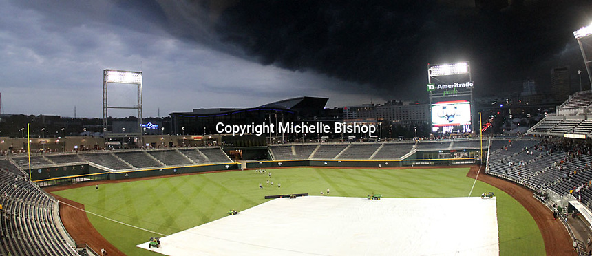 The view from the press box as a storm system with heavy winds and rain passes over TD Ameritrade Park on June 20, 2011. Tornado sirens blared because of high winds, but no tornado warning was issued for the Omaha area. The game between Vanderbilt and Florida was suspended in the sixth inning after a two-and-a-half hour delay. (Photo by Michelle Bishop)