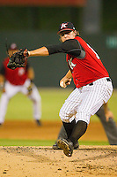 Relief pitcher Nick McCully #12 of the Kannapolis Intimidators in action during the South Atlantic League game against the Lakewood BlueClaws at Fieldcrest Cannon Stadium on July 16, 2011 in Kannapolis, North Carolina.  The Intimidators defeated the BlueClaws 5-3.   (Brian Westerholt / Four Seam Images)