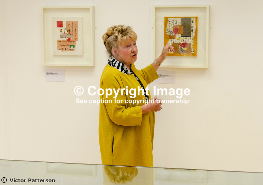 Mavis Thomson, artist, right, discusses one of her exhibits. The exhibition included the work of her two daughters, Marion and Sydney, both very accomplished artists in their own right. Mavis, who lives in Enniskillen, Co Fermanagh, N Ireland, is a member of the Royal Ulster Academy, Ulster Society of Woman Artists, Watercolour Society of Ireland, Ulster Watercolour Society and the Turner Society. 201805254836<br /><br />Taken at art exhibition, &ldquo;Three Ways of Seeing&rdquo;, in the Strule Arts Centre, Omagh, Co Tyrone, 25th May 2018.<br />The event showcased the work of not just of Mavis, but her equally talented daughters, Marion and Sydney. <br /><br />Copyright Image from Victor Patterson, 54 Dorchester Park, <br />Belfast, UK, BT9 6RJ<br /><br />t1: +44 28 9066 1296 (from Rep of Ireland 048 9066 1296)<br />t2: +44 28 9002 2446 (from Rep of Ireland 048 9002 2446)<br />m: +44 7802 353836<br /><br />victorpatterson@me.com<br />victorpattersonbelfast@gmail.com<br /><br />Please see my Terms and Conditions of Use at victorpatterson.com. It is IMPORTANT that you familiarise yourself with them.<br /><br />Images used on the Internet incur an additional cost and must be visibly watermarked i.e. &copy;Victor Patterson within the body of the image and copyright metadata must not be deleted. Images used on the Internet have a size restriction of 4kbs and are chargeable at rates available at victorpatterson.com.<br /><br />This image is available only for the use of the download recipient i.e. television station, newspaper, magazine, book publisher, etc, and must not be passed on to any third party. It is also downloaded on condition that each and every usage is notified within 7 days to victorpatterson@me.com<br /><br />The right of Victor Patterson (or the named photographer) to be identified as the author is asserted in accordance with The Copyright Designs And Patents Act (1988). All moral rights are asserted.