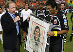 20 Octoboer 2007: DC's President Kevin Payne (l) presents a signed picture to Marco Etcheverry after the game. The 1997 DC United team defeated Hollywood United 2-1 in the Marco Etcheverry tribute match played before a regular season MLS game at RFK Stadium in Washington, DC.
