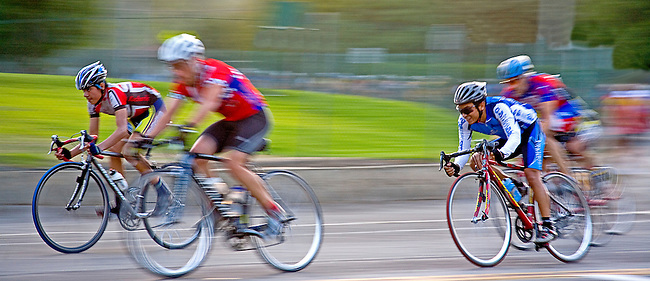 MEMBERS OF A PASADENA, CALIFORNIA CYCLING CLUB ARE A BLUR DURING AN EVENING RUN AT THE ROSE BOWL
