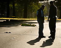 Rohnert Park Public Safety Department officers Ryan Foiles, left, and David Sutter investigate the scene of a fatal accident where a pedestrian was struck by a vehicle on Rohnert Park Expressway in Rohnert Park, Calif., on May 10, 2013. (Alvin Jornada / For The Press Democrat)