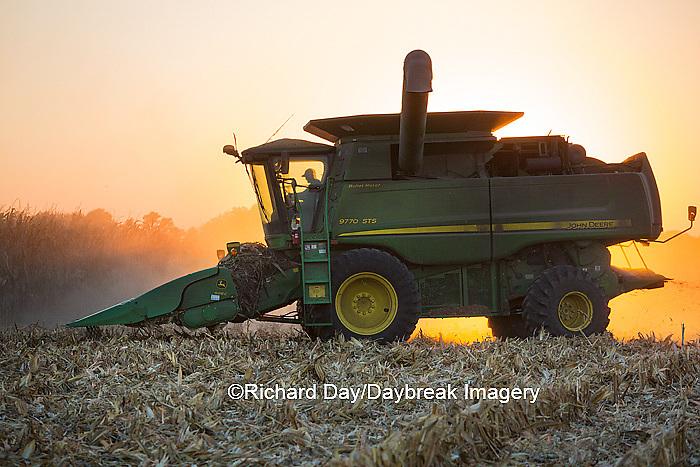 63801-06720 John Deere combine harvesting corn at sunset, Marion Co., IL