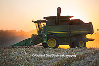 63801-06720 John Deere combine harvesting corn at sunset, Marion Co., IL
