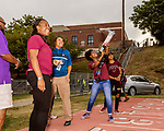 September 21, 2017. Durham, North Carolina.<br /> <br /> Isis Wilson shoots a t-shirt into the air during pregame celebrations. <br /> <br /> The NCCU Eagles won a home game against the the South Carolina State Bulldogs 33-28 at O'Kelly–Riddick Stadium.