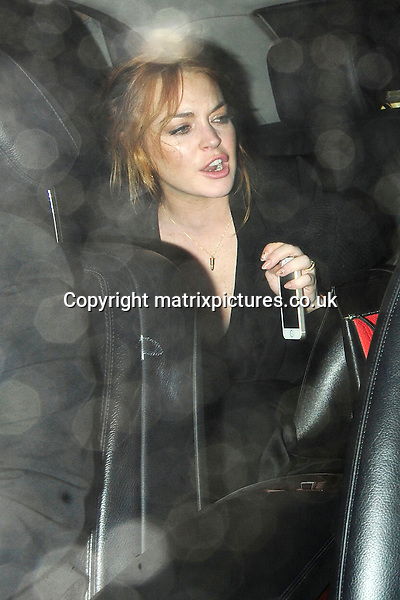 NON EXCLUSIVE PICTURE: MATRIXPICTURES.CO.UK<br /> PLEASE CREDIT ALL USES<br /> <br /> WORLD RIGHTS<br /> <br /> American actress Lindsay Lohan is pictured at 2am with a mystery male companion as she leaves The Chiltern Firehouse, in London, via the back door.<br /> <br /> The 27 year old appeared to be in good spirits, although seemed a little worse for wear as she failed to notice her bra was on full display! <br /> <br /> MAY 29th 2014<br /> <br /> REF: ASI 142562