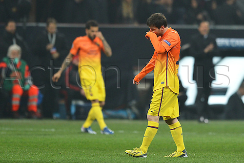 20.02.2013. Milan, Italy.   Football Champions League Knock-out stages leg 1.   AC Milan versus Barcelona.  Lionel Messi Barcelona looks dejected at the end of the game
