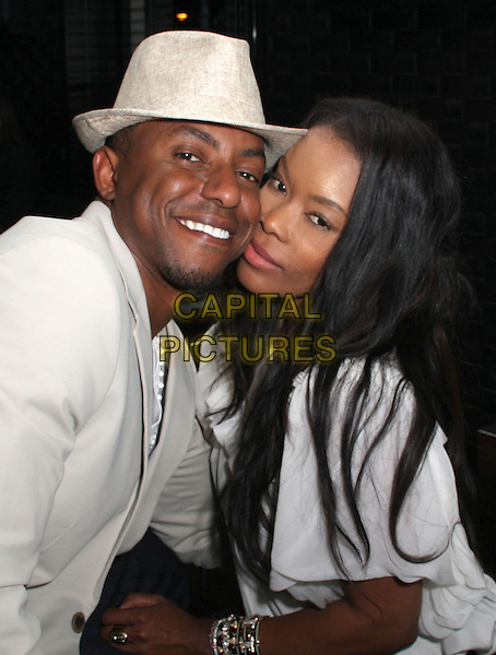 GUEST & GOLDEN BROOKS .Angels Of East Africa Celebrity Charity Event held at The Social, Hollywood, California, USA..November 7th, 2008.half length white hat grey gray posing .CAP/ADM/KB.©Kevan Brooks/AdMedia/Capital Pictures.