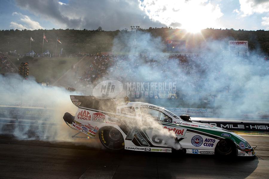 Jul. 19, 2013; Morrison, CO, USA: NHRA funny car driver John Force during qualifying for the Mile High Nationals at Bandimere Speedway. Mandatory Credit: Mark J. Rebilas-